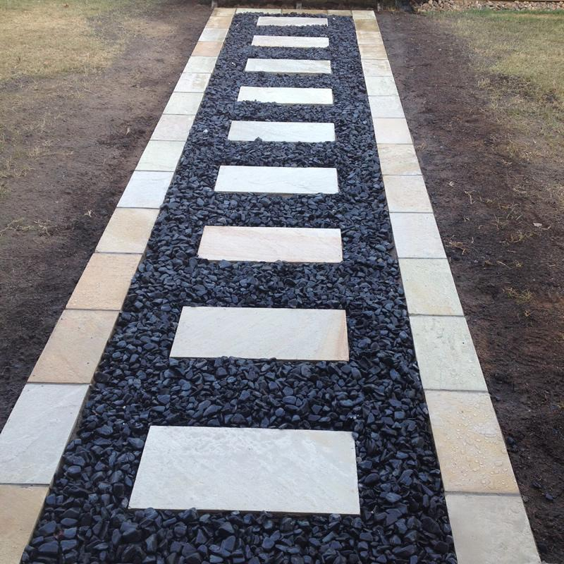 Sandstone Paver Edging with Stepping Stones and Charcoal Pebbles