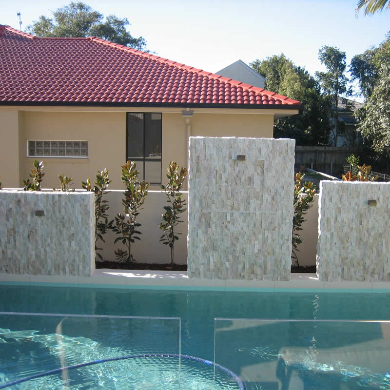 Stone water features swimming pool