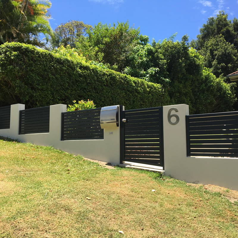 Rendered fence, aluminium feature