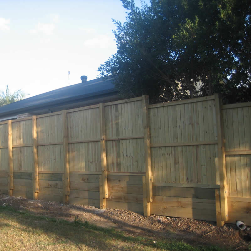 Timber fence and retaining wall